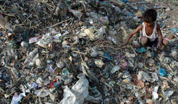 Boy sifts through landfill